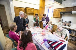 Pride of Place judges with resident knitting group at Tait House Community Enterprise.