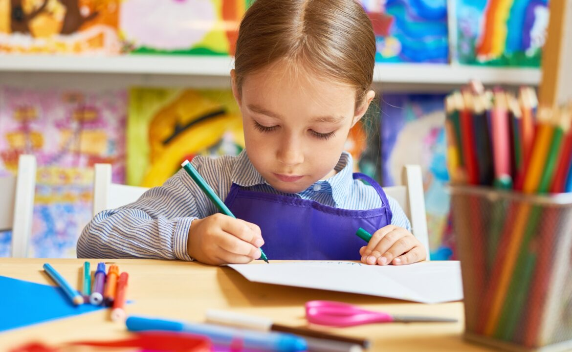 Little Girl Drawing in Pre-School